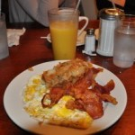 Have brunch after attending a gospel mass at Amy Ruth's restaurant